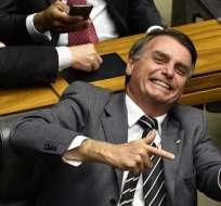 Hijos de Bolsonaro asumen protagonismo de campaña en Brasil. Foto: AFP