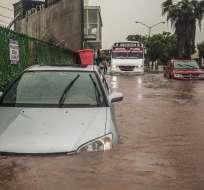 Tres muertos y tres desaparecidos por lluvias torrenciales en México. Foto: AFP