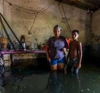 Comercios, casas, edificios y carreteras de Vargas resultaron afectadas. Foto: AFP