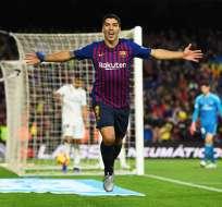 Luis Suárez ejecutó un triplete impactante durante el duelo con el Madrid. Foto: AFP.