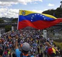 CARACAS, Venezuela.- Opositores al gobierno de Nicolás Maduro durante una movilización convocada por Juan Guaidó. Foto: AFP.