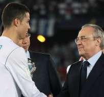 Cristiano Ronaldo junto al presidente del Real Madrid.