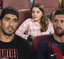 Mateo Messi (en las piernas del papá) salió en todas las redes sociales. Foto: JOSEP LAGO / AFP
