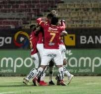 Jugadores de Deportivo Cuenca festejan uno de los goles. Foto: API.