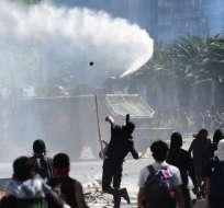 Miles se manifestaron en una plaza del centro de Santiago. Foto: AFP