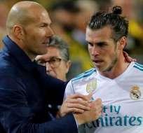 Zinedine Zidane, junto a Gareth Bale.