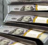 La inflación permite hacer planes a futuro porque los salarios no se contraen. Foto referencial / AP