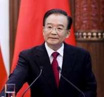 China urge a Siria a formar gobierno de transición, tras oír plan de Al Asad