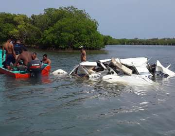 HONDURAS.- La avioneta cayó cerca de la localidad de Dixon Cove, fallecieron todos sus ocupantes. Foto: AFP