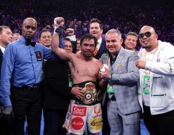 El boxeador filipino ganó por decisión dividida al estadounidense. Foto: JOHN GURZINSKI / AFP